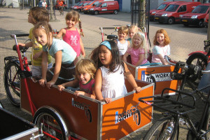 Photo by Workcycles: 9-girls-in-a-bakfiets.JPG. Creative Commons license.